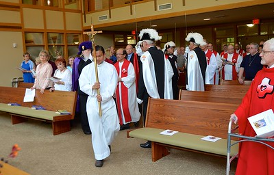 Paul, one of our novices, leads the procession; he is followed by Fr. Quang, superior of the Sacred Heart Community at SHML