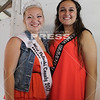 Miss Pulaski County Maddie Ruff received help from Indiana Simmental Queen Kristen Buck on July 4 during the 4-H Beef Show.