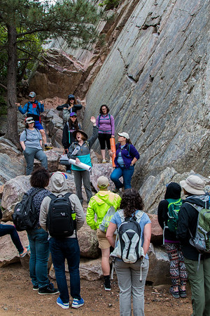CU graduate student Jacky Baughman explains geologic processes during a field trip with UNAVCO GeoLaunchpad and RESESS interns. (Photo/Christopher Chase Edmunds, UNAVCO)