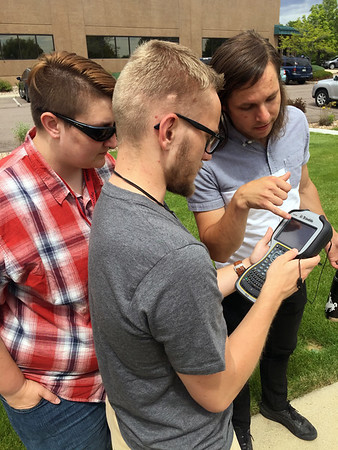 UNAVCO engineer Spence Niebuhr discusses GPS with 2017 RESESS interns Theron Sowers and Zachary Little.  (Photo/Aisha Morris, UNAVCO)