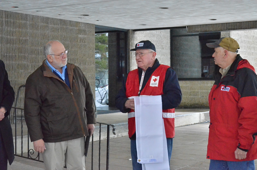 . Leah McDonald - Oneida Daily Dispatch Mayor Leo Matzke, left, listens to Red Cross volunteer Carl Carlstead on Friday, March 24, 2017, at Oneida City Hall.