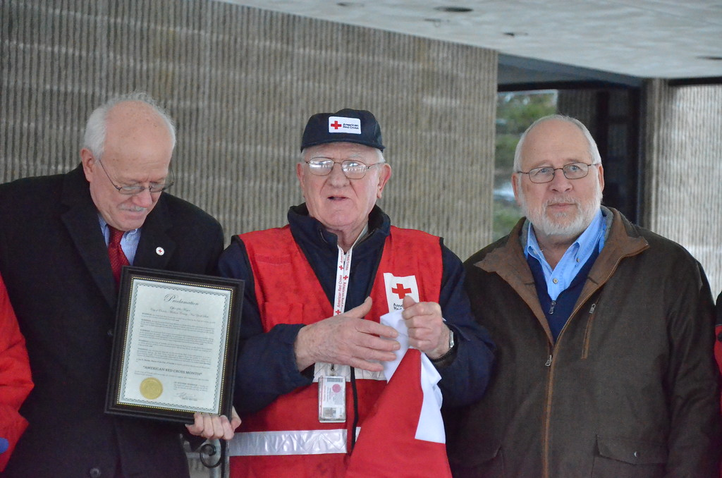 . Leah McDonald - Oneida Daily Dispatch Pat Powers, left, holds the proclamation naming March as Red Cross Month in the city of Oneida while Mayor Leo Matzke, right, and Red Cross volunteer Carl Carlstead look on at City Hall in Oneida on Friday, March 24, 2017.