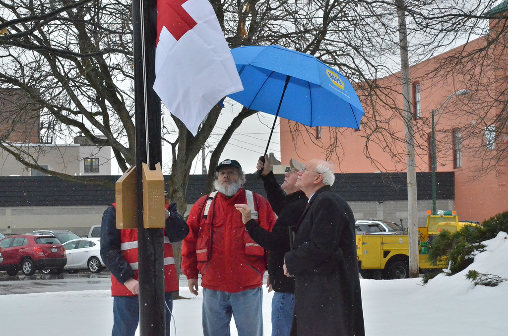 . Leah McDonald - Oneida Daily Dispatch Red Cross volunteers raise the Red Cross flag at City Hall in Oneida on Friday, March 24, 2017.