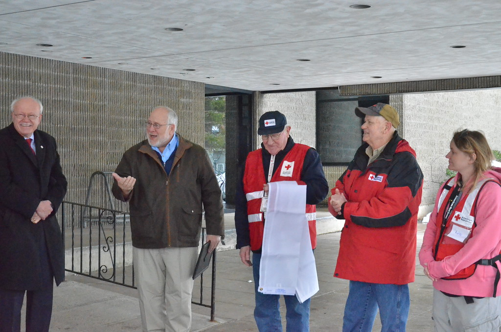 . Leah McDonald - Oneida Daily Dispatch Mayor Leo Matzke, center, talks with Pat Powers, left, and Red Cross volunteers on Friday, March 24, 2017, at Oneida City Hall.