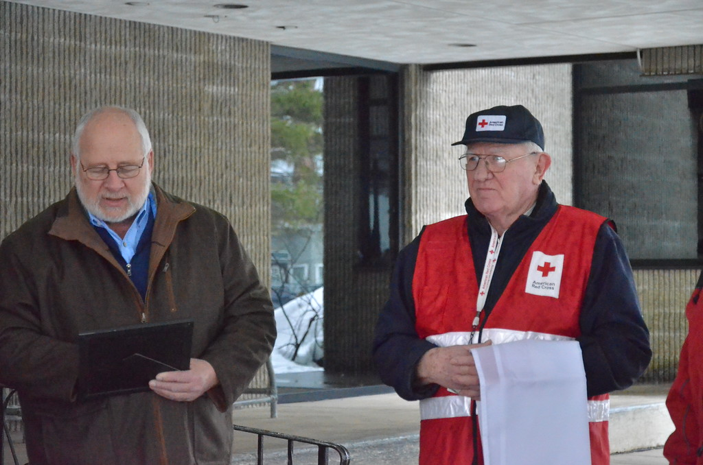 . Leah McDonald - Oneida Daily Dispatch Mayor Leo Matzke, left, reads a proclamation declaring March as Red Cross Month while volunteer coordinator Carl Carlstead listens at City Hall in Oneida on Friday, March 24, 2017.