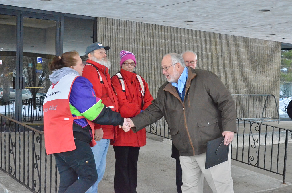 . Leah McDonald - Oneida Daily Dispatch Mayor Leo Matzke shakes the hands of Red Cross volunteers at City Hall in Oneida on Friday, March 24, 2017.