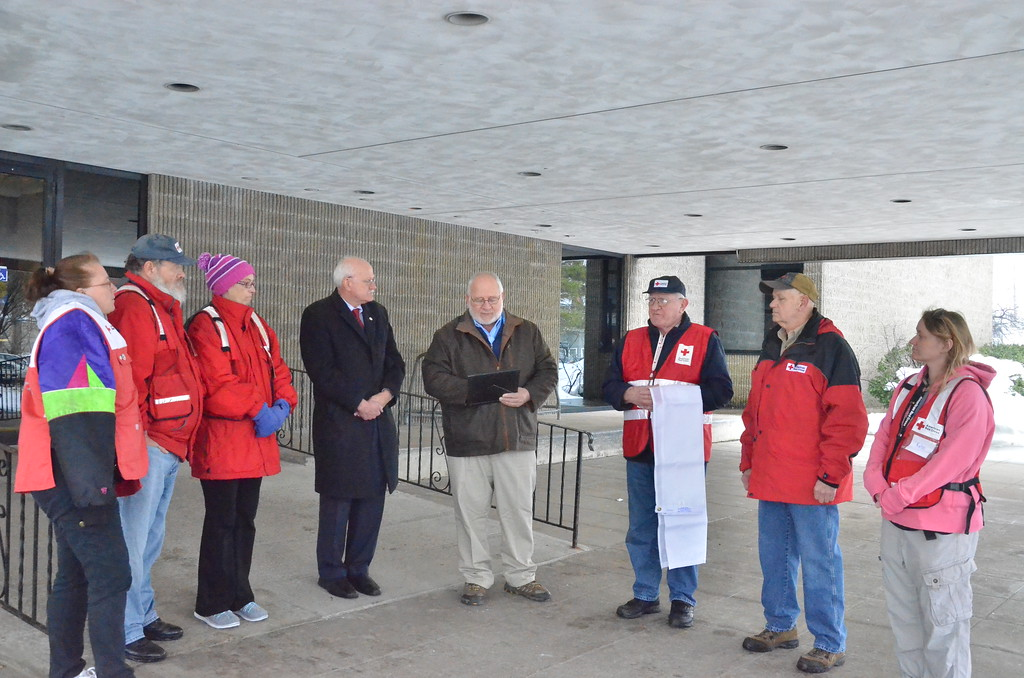 . Leah McDonald - Oneida Daily Dispatch Mayor Leo Matzke, center, reads a proclamation declaring March as Red Cross Month while Red Cross volunteers and chairman Pat Powers, center left, listen at City Hall in Oneida on Friday, March 24, 2017.