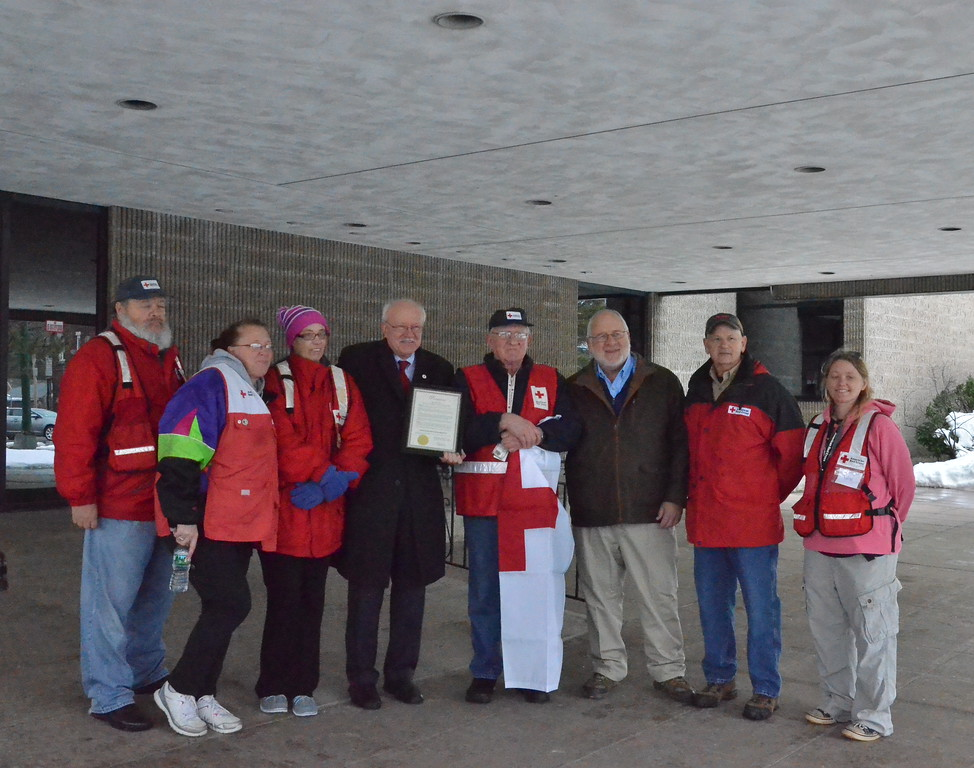 . Leah McDonald - Oneida Daily Dispatch Red Cross volunteers stand with Mayor Leo Matzke and Madison-Oneida Red Cross chapter chairman Pat Powers at City Hall on Friday, March 24, 2017.