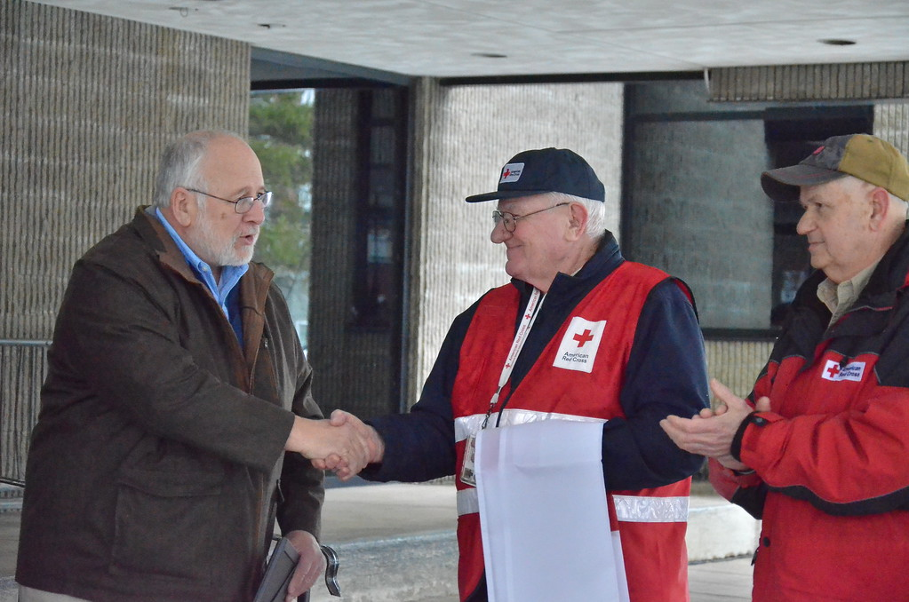 . Leah McDonald - Oneida Daily Dispatch Mayor Leo Matzke shakes Red Cross volunteer coordinator Carl Carlstead\'s hand at City Hall in Oneida on Friday, March 24, 2017.