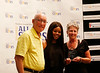 HOLLY PELCZYNSKI - BENNINGTON BANNER Gabby Douglas stands with the 2017 courage award winners John and Judy Werner who were heavily involved in their community and highschool sports and have battled cancer.