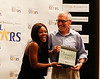 HOLLY PELCZYNSKI - BENNINGTON BANNER Gabby Douglas hands out awards to all the athletes and coaches during the 2017 Regional All Stars Gala held on Tuesday evening at Bennington College. Above Burr and Burton coach Trey Spencer accepts an award.