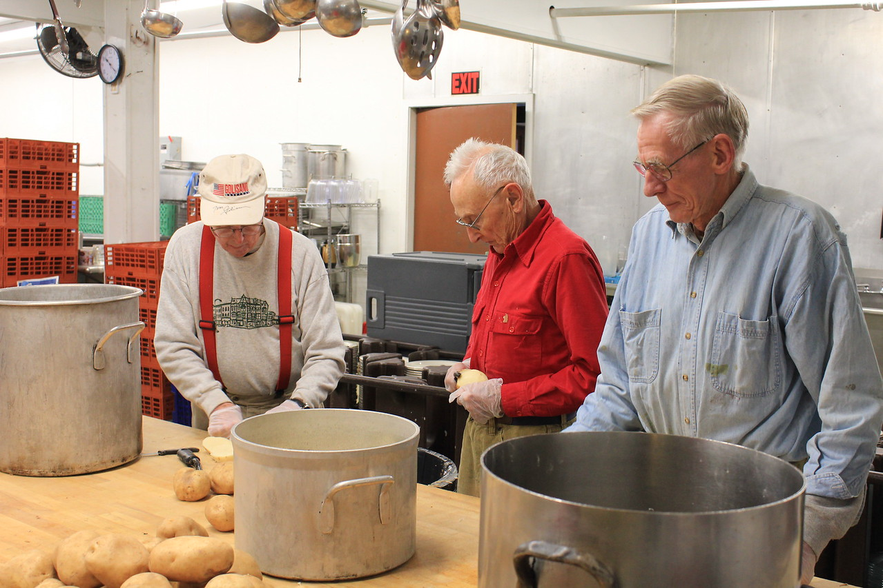 Charles Pritchard - Oneida Daily Dispatch From left to right, Rotarians Jack Wallace, Pete Froass and Perry Tooker III work peel and chop potatoes on Nov. 20 2017 at Dibbles Inn.
