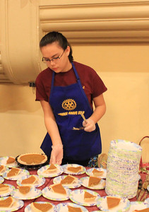 Charles Pritchard - Oneida Daily Dispatch Rotary Interact member Rachael Kohler cuts and serves pumpkin pie for guests at the Rotary Thanksgiving luncheon, Nov. 22, 2017.