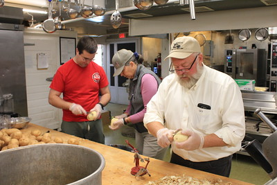 Charles Pritchard - Oneida Daily Dispatch From left to right, Rotarians Matt Lacy, Mary Pat Adams and Perry Tooker IV peel and cut potatoes on Nov. 20 2017 at Dibbles Inn