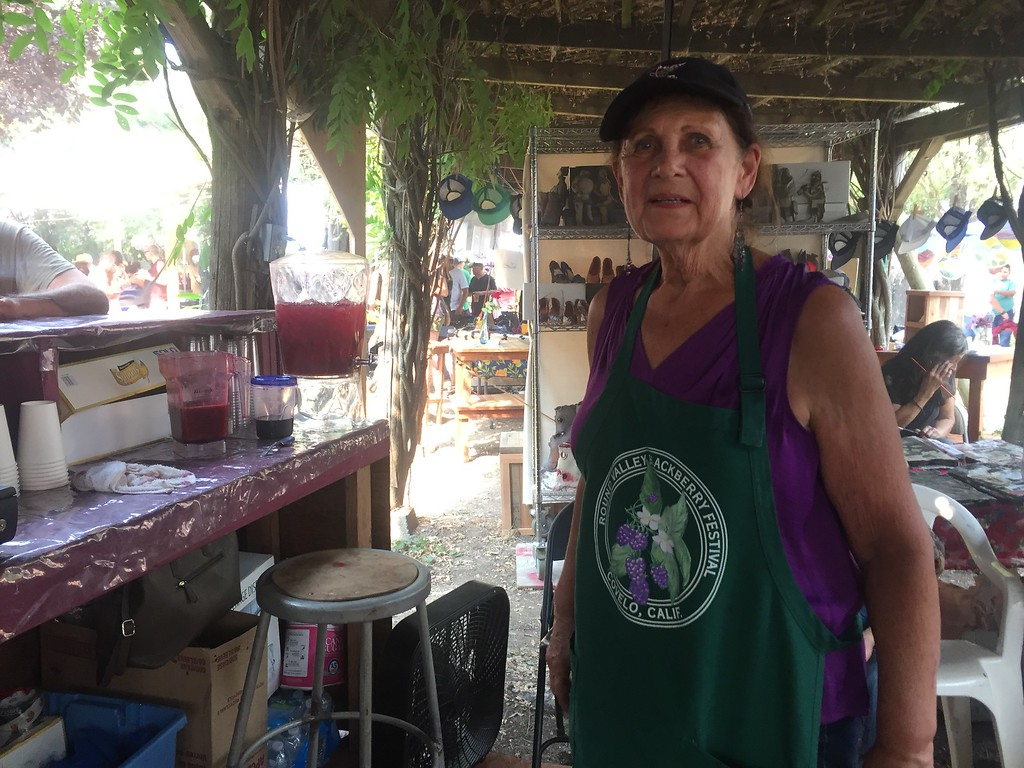 . Myrna Rountree, the original blackberry slush maker, in her booth. She\'s been making blackberry treats at the festival every year since it started. Hillary Ojeda-The Willits News
