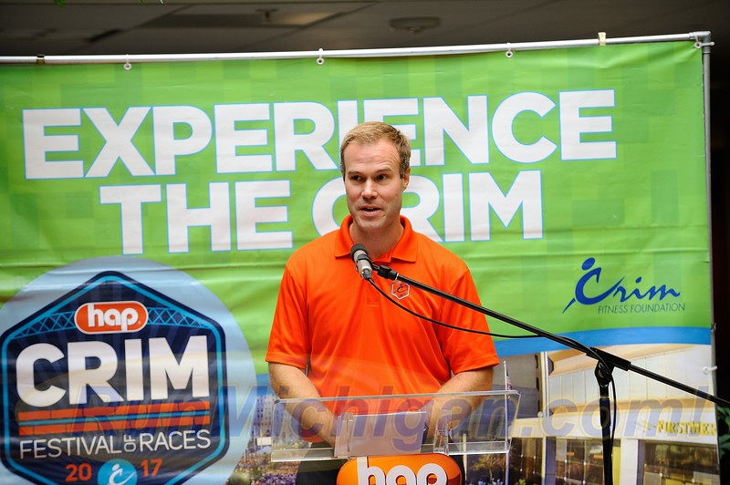 HAP Crim Festival of Races Race Director Andrew Younger speaks to the audience assembled at the Flint. Twp. offices of HAP on August 24, 2017.