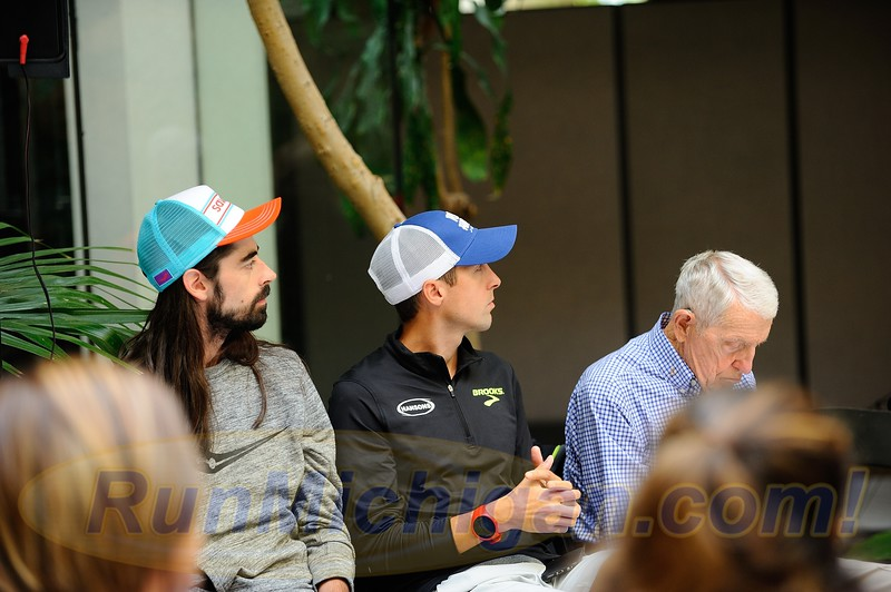 (L-R) Noah Droddy, Dathan Ritzenhein and race co-founder Bobby Crim waiting to speak at the 2017 HAP Crim Festival of Races Pre-Race Press Event in Flint Twp., Michigan on August 24, 2017.