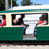 A passenger on Otto's miniature steam train waves to passersby during his ride around the fair on Friday, Sept. 8. The miniature train, which debuted at the fair in 1974, is a replica of a Burlington and Quincy 3000 4-6-4 Class S4 Hudson.