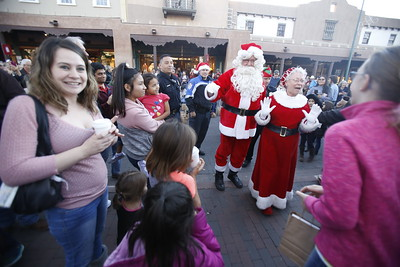 Mr and Mrs Claus arrive a the Plaza for the Holiday Lighting on the Plaza on Friday, November 24, 2017. Luis Sánchez Saturno/The New Mexican