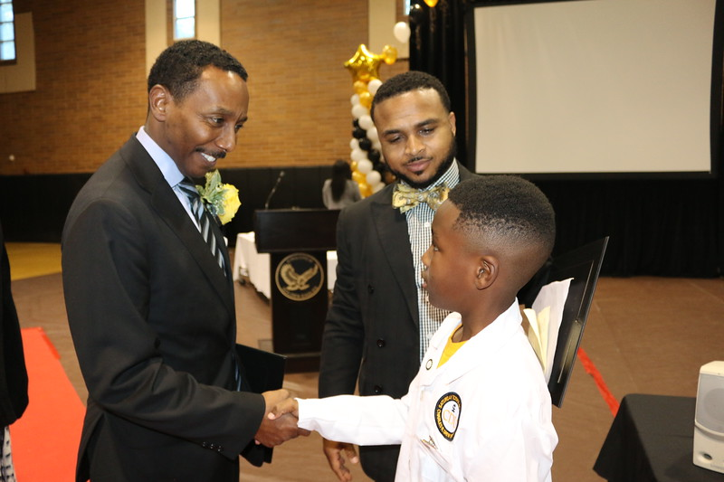 SSAII Student Angelo Higgins meets UCLA's Medical Center Dr. Charles C. Flippen, keynote speaker, invited by MC and Attorney Jaaye Person-Lynn, also a member of 100 Black Men.