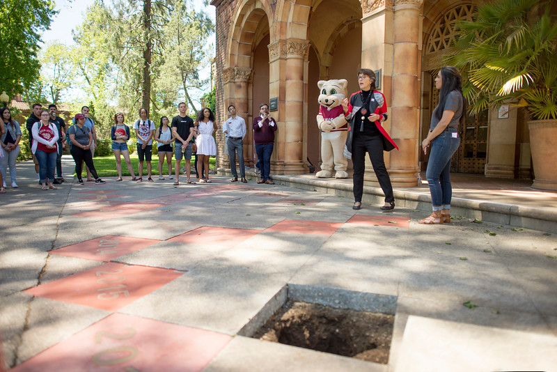 Alisha Sharma (left) and President Gayle Hutchinson (right) speak in front of Kendall Hall during the Class of 2017 time capsule burial on Tuesday May 2, 2017 in Chico, Calif. Graduating students placed symbolic items into the time capsule, which is buried and will not be reopened until the year 2067. <br /> (Jessica Bartlett/ Photographer)