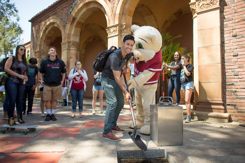 Chico State students help bury the Class of 2017 time capsule on Tuesday May 2, 2017 in Chico, Calif. Graduating students placed symbolic items into the time capsule, which is buried and will not be reopened until the year 2067. <br /> (Jessica Bartlett/ Photographer)