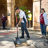 Graduating senior, Jose Diaz (center), helps bury the Class of 2017 time capsule on Tuesday May 2, 2017 in Chico, Calif. Graduating students placed symbolic items into the time capsule, which is buried and will not be reopened until the year 2067. <br /> (Jessica Bartlett/ Photographer)