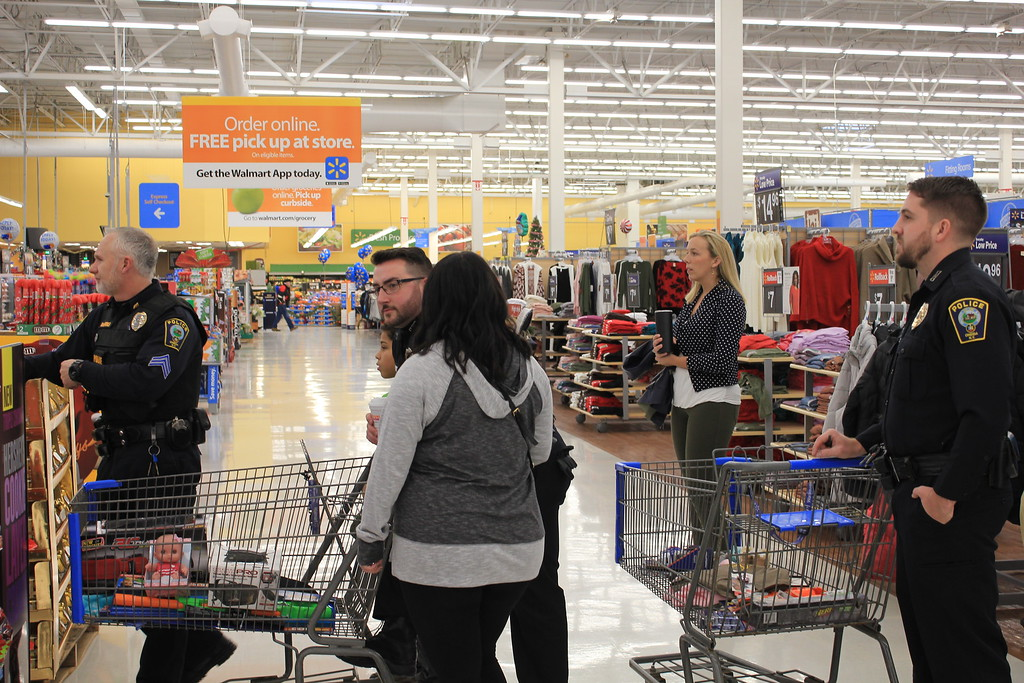 . Charles Pritchard - Oneida Daily Dispatch Oneida City Police officers escort Oneida city school students on a shopping spree at Walmart as part of the annual Shop with a Cop community outreach on Saturday, Dec. 9, 2017.