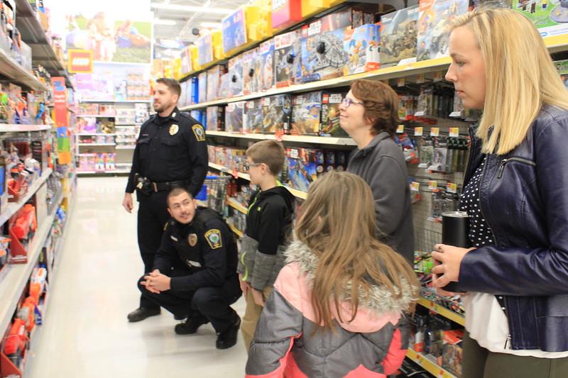 Charles Pritchard - Oneida Daily Dispatch Oneida City Police officers escort Oneida city school students on a shopping spree at Walmart as part of the annual Shop with a Cop community outreach on Saturday, Dec. 9, 2017.