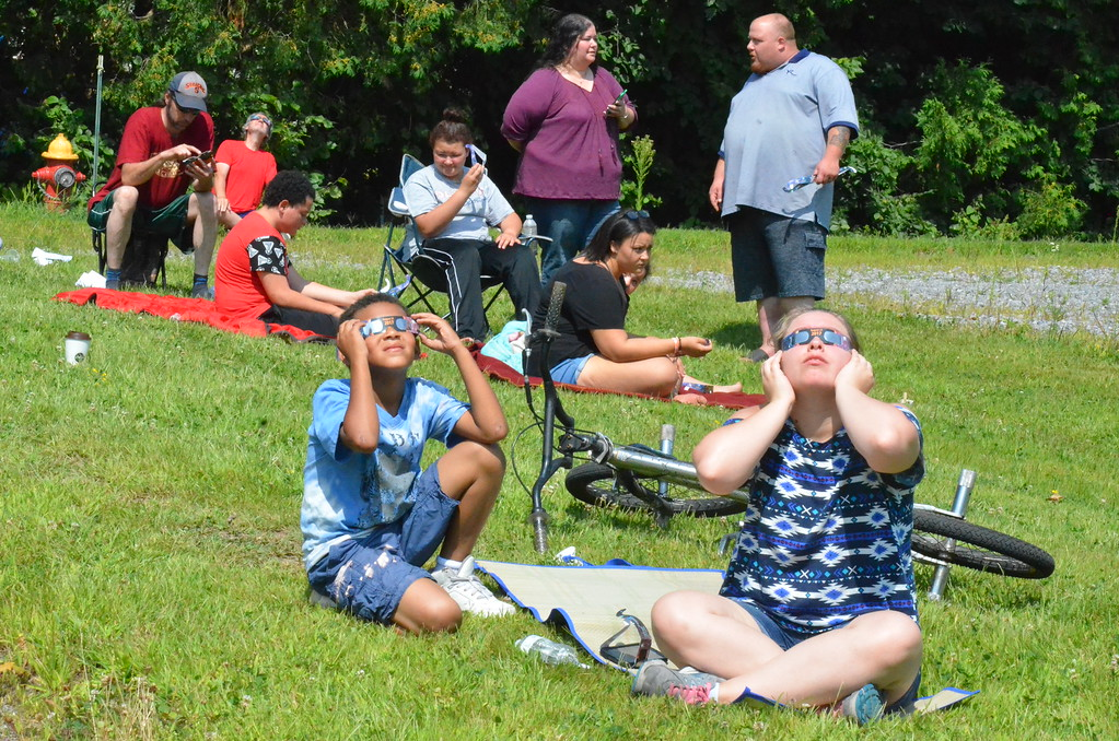 . Leah McDonald - Oneida Daily Dispatch Hundreds turn out to the future site of the Oneida Public Library on Monday, Aug. 21, 2017, to see the Great American Solar Eclipse. Local viewers got to see about 70 percent coverage of the sun.