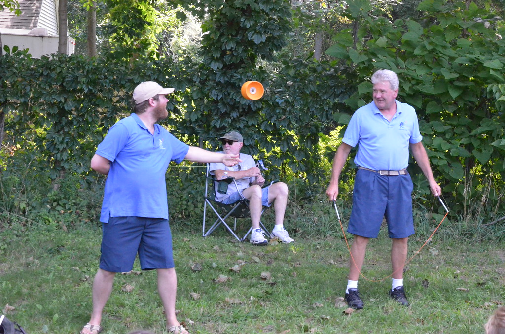 . Leah McDonald - Oneida Daily Dispatch Jugglers entertain the hundreds who turned out to the future site of the Oneida Public Library on Monday, Aug. 21, 2017, to see the Great American Solar Eclipse. Local viewers got to see about 70 percent coverage of the sun.