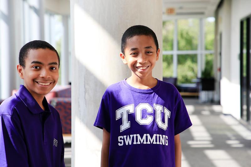 TCU students Carson Huey, 14,  his little brother, <br /> Cannan, 11, with their mom, Claretta Kimp,