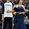 Escorted by Eric Kremer, Courtney Hoene waves to the crowd after being crowned Teutopolis' 2017 homecoming queen Friday evening at Teutopolis High School.<br /> Chet Piotrowski Jr. photo/Piotrowski Studios