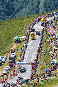 The publicity caravan heads uphill to the finish.  Photos from Stage 12 of the 2017 Tour de France (Pau to Peyragudes). Taken from the Izorad hospitality area with about 400 meter to go.  Nikon D500 Tamron SP 70-200mm f/2.8 Di VC