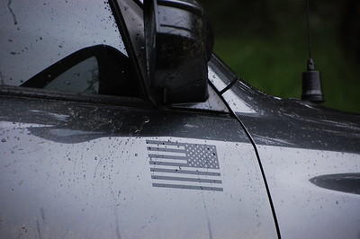 2017 4Runner: Subdued, mirror image American flag decals on the doors.    These were removed after about 18 months due to being scratched up from brush.
