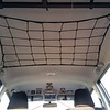 Paracord frame, 28x28 bungee net, Camjam rope tightener, and 28 mini zip ties made this ceiling net for the 4Runner.  It is stretched between the passenger grab handles and the Big Sky gun rack.