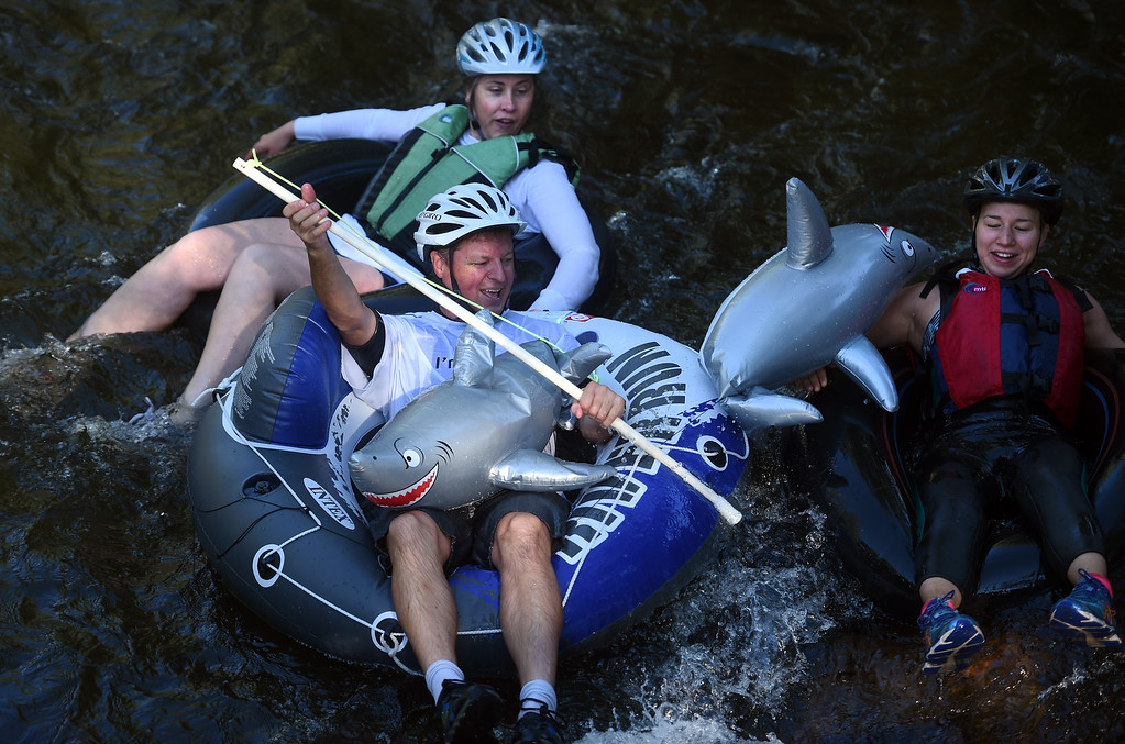 """. A few tubers were \""""attacked\"""" by sharks  during the 10th Annual Tube to Work Day in Boulder on Friday.For more photos and videos, go to dailycamera.com.  Cliff Grassmick  Staff Photographer July 14, 2017"""