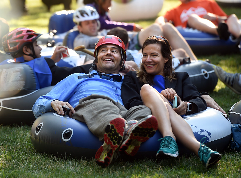. Matt Wolfe. left, and Lacey Croco,  relax  before the 10th Annual Tube to Work Day in Boulder on Friday.For more photos and videos, go to dailycamera.com.  Cliff Grassmick  Staff Photographer July 14, 2017