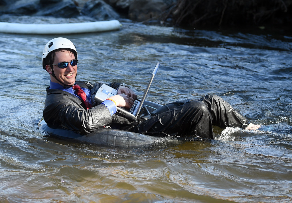 . THis man has a used laptop for sale after riding the waves of Boulder Creek  during the 10th Annual Tube to Work Day in Boulder on Friday.For more photos and videos, go to dailycamera.com.  Cliff Grassmick  Staff Photographer July 14, 2017