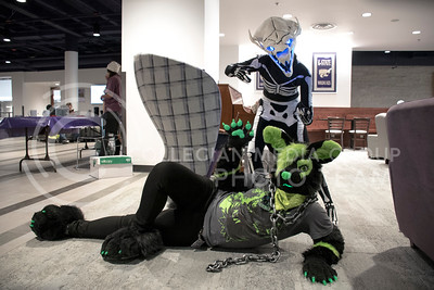 First Place Overall Winner Kylee Norris as Gaster Blaster from the famous franchise Undertale poses with Second Place Overall Winner Alex Mac as an orignal character Virus Sector for the Costume Contest held in the Kansas State Student Union in Manhattan, KS, on Oct. 31, 2017. (Olivia Bergmeier | Collegian Media Group)