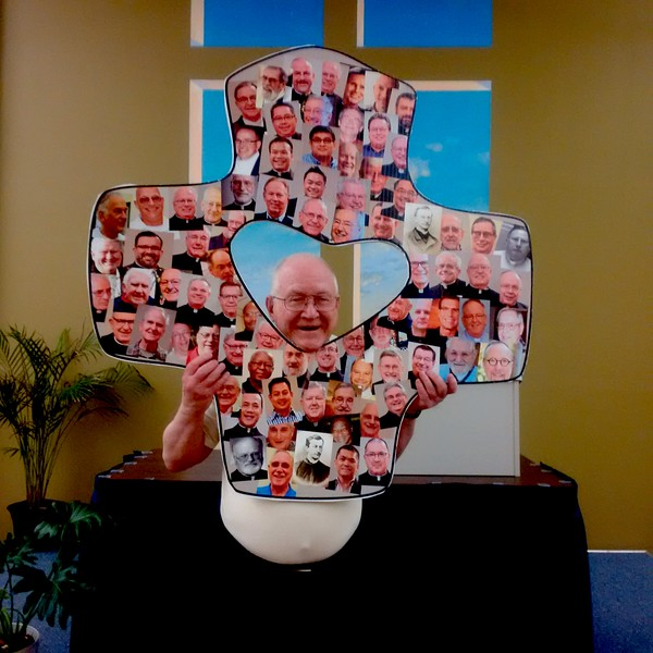 Somehow we missed getting Fr. Bernie in the photo so he went ahead and put himself in it!