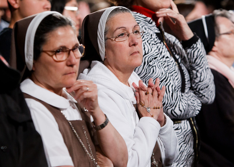 Religious women kneel as New York Cardinal Timothy Dolan celebrates the Eucharist at the Vigil Mass for Life, held Jan. 26 at the Basilica of the National Shrine of the Immaculate Conception in Washington, D.C. <br /> Pilot photo/ Gregory L. Tracy