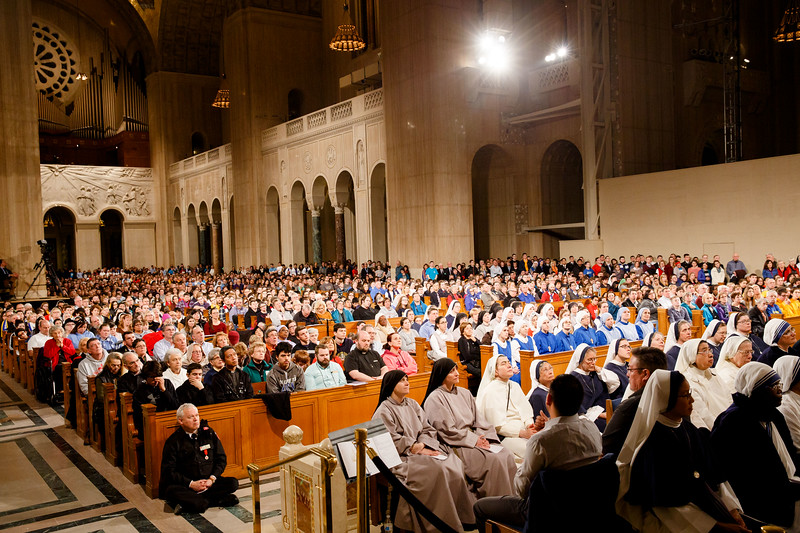 Massgoers listen as New York Cardinal Timothy Dolan delivers his homily at the Vigil Mass for Life, held Jan. 26 at the Basilica of the National Shrine of the Immaculate Conception in Washington, D.C. <br /> Pilot photo/ Gregory L. Tracy