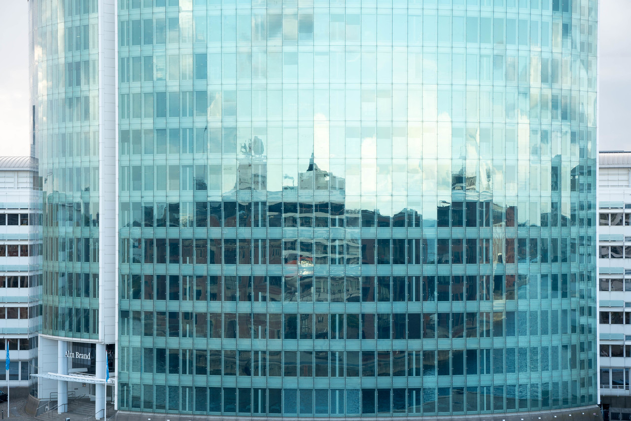 Interesting reflection off this curved building. What do you see?