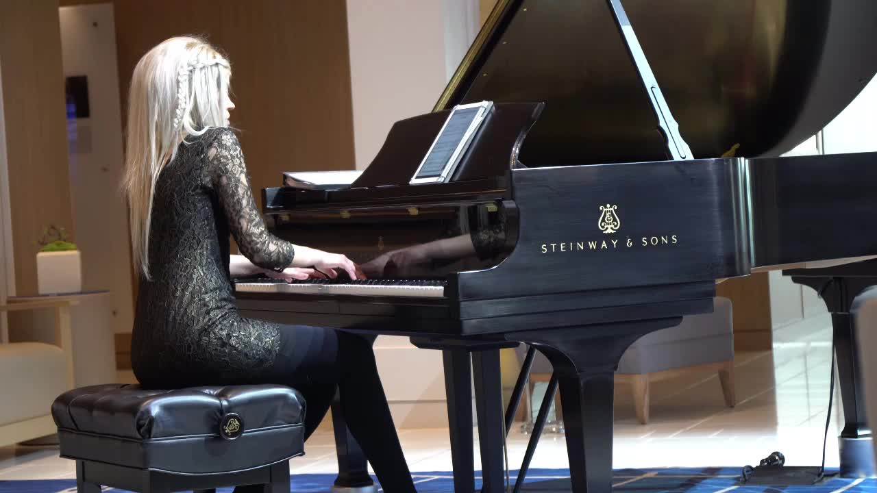 Eva, the resident pianist abord ship