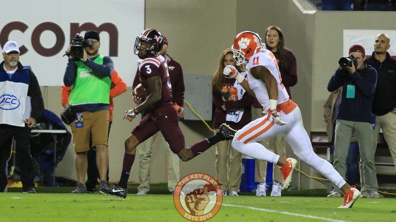 Greg Stroman gets chased by Clemson's Isaiah Simmons on a long punt return to set up first and goal. (Mark Umansky/TheKeyPlay.com)