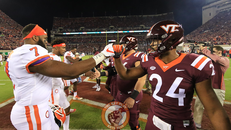 Anthony Shegog (24) and the rest of Virginia Tech captains meet the Clemson captains for the coin toss. (Mark Umansky/TheKeyPlay.com)