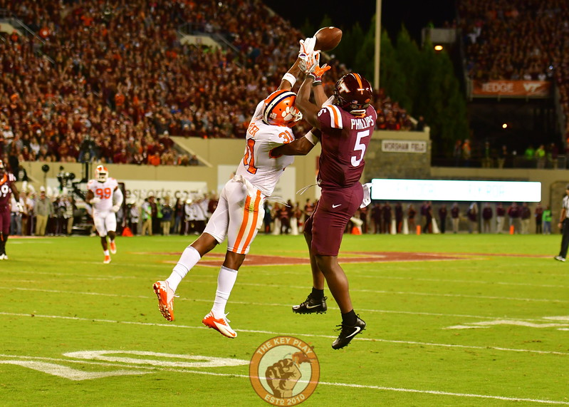 Cam Phillips (#5) and Clemson's Ryan Carter (#31) leap to pull down this pass from Josh Jackson, in the 3rd Quarter  (Dan Lohmann/TheKeyPlay.com)