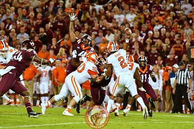 DT Tim Settle, #4 gets his hands up in an attempt to breakup Bryant's pass.