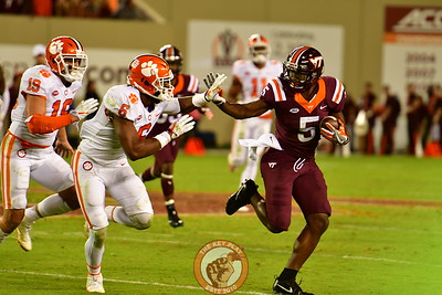 Cam Phillips #5, avoids defenders to extend  his completion (Dan Lohmann/TheKeyPlay.com)